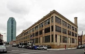 NEWSPAPER DELIVERY SERVICE RELOCATES LIC HQ